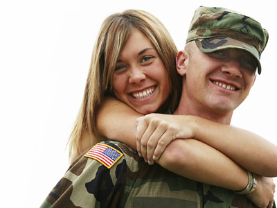 soldier give girlfriend a piggyback ride